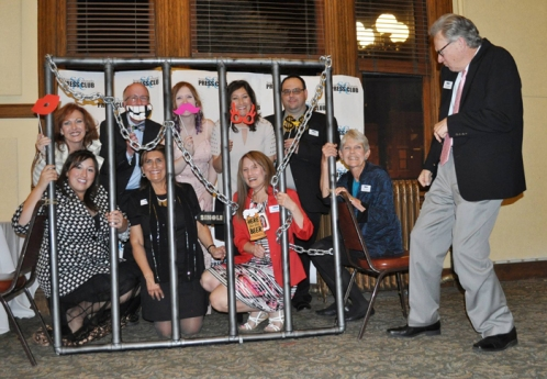 """The board having fun at the """"cell-fie"""" photo booth!"""