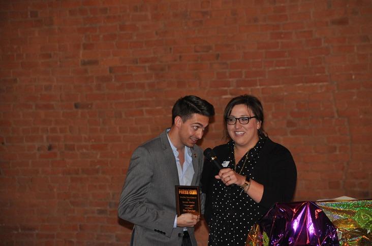 Alyssa Parga presents the Media Excellence award for social media to Tim Zercher of EasySocial.