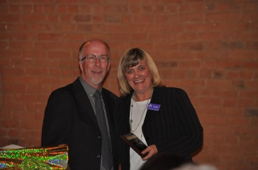 Southern Colorado Press Club Vice President Scott Jones presents the Media Excellence award for graphic design to Ally Sullivan.