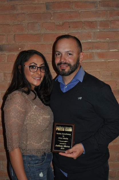 Anthony A. Mestas, with guest, shows off his Media Excellence award for print for his work at The Pueblo Chieftain.