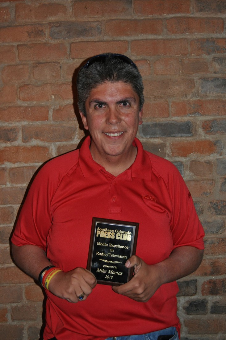 TV photojournalist Mike Macias shows off his Media Excellence award for his work at KRDO NewsChannel 13.