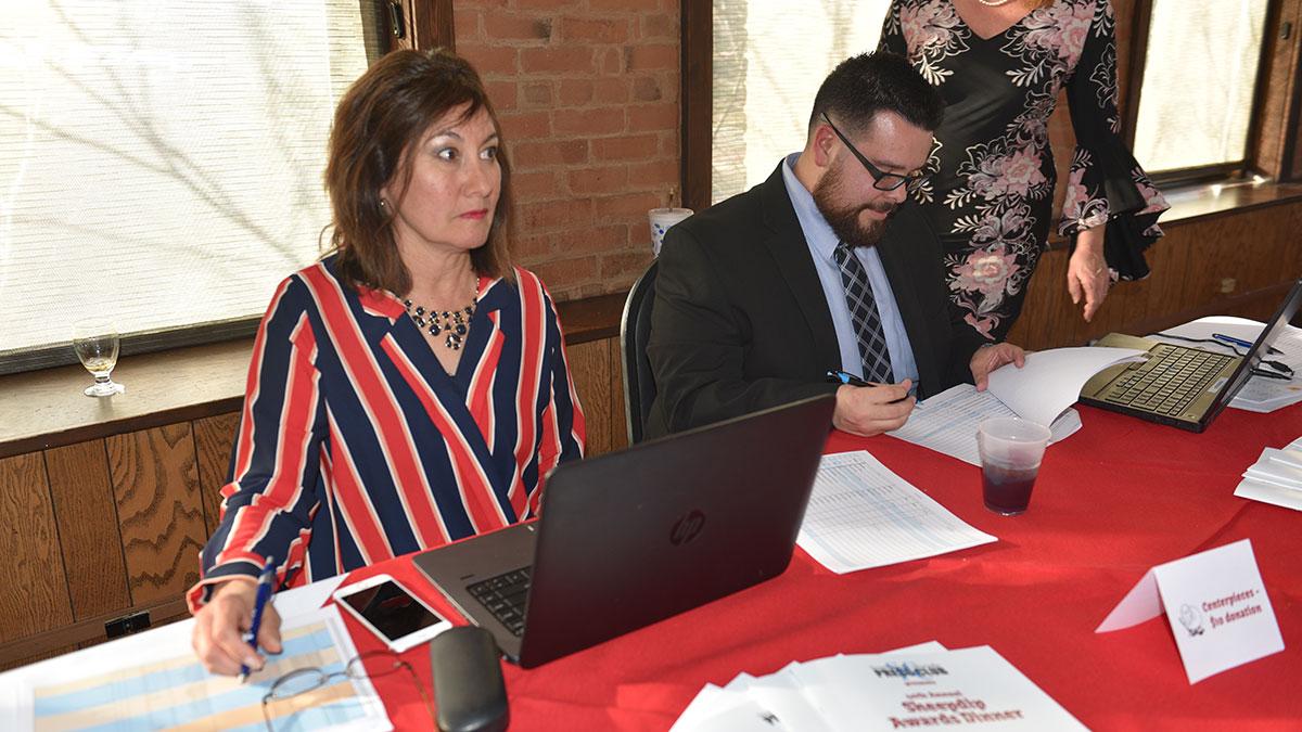SCPC board members Sandy Romero and Steve Medina check in Sheedip 2019 guests.