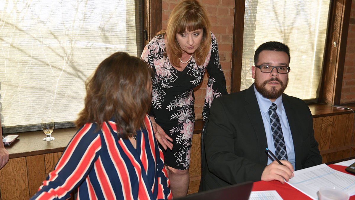 SCPC board members Sandy Romero, Amber Shipley and Steve Medina check in Sheedip 2019 guests.