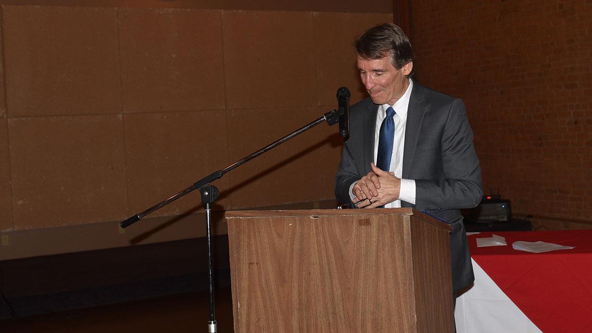 Dave Feamster accepts the Mel Harmon Award