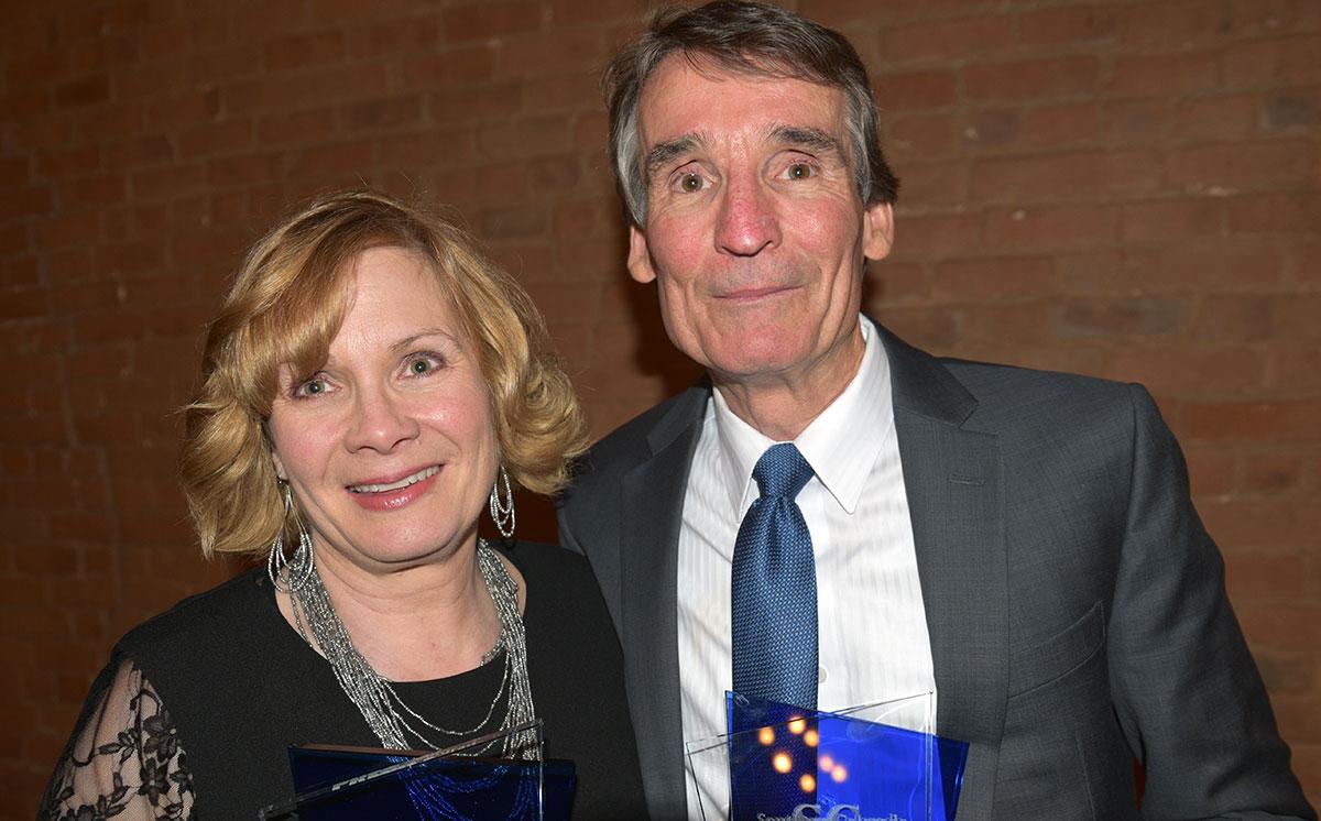 Damon Runyon Award winner Tracy Harmon and Mel Harmon Award winner Dave Feamster