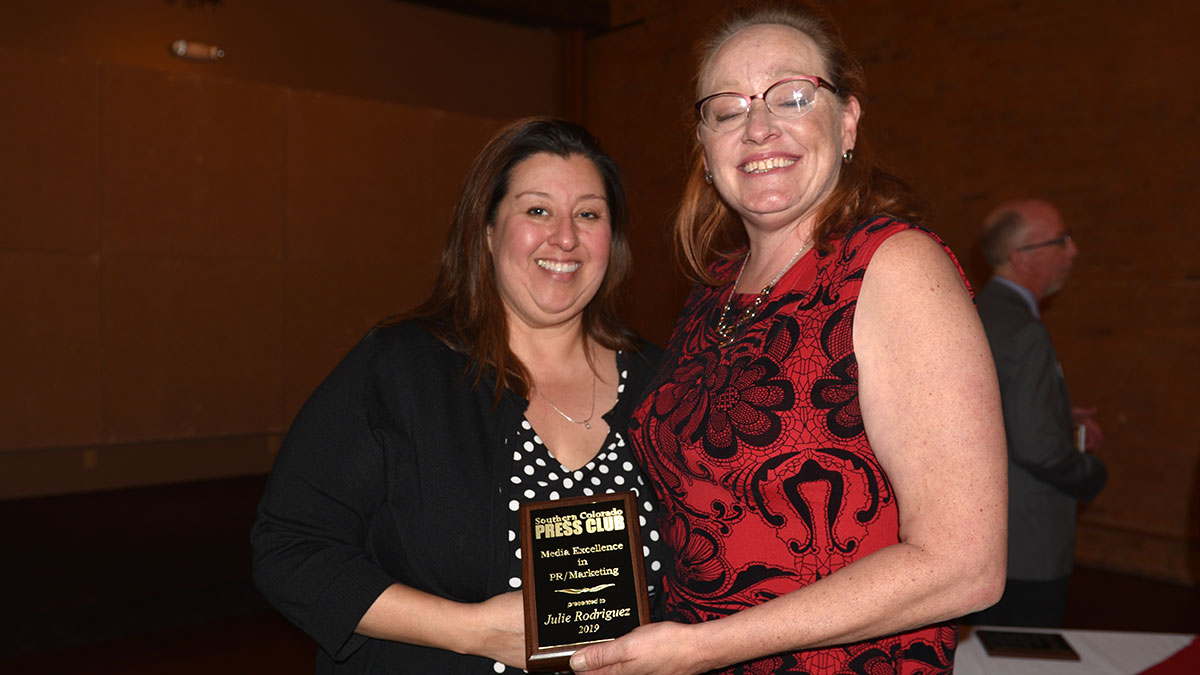 Julie Rodriguez accepts her Media Excellence Award for PR/Marketing