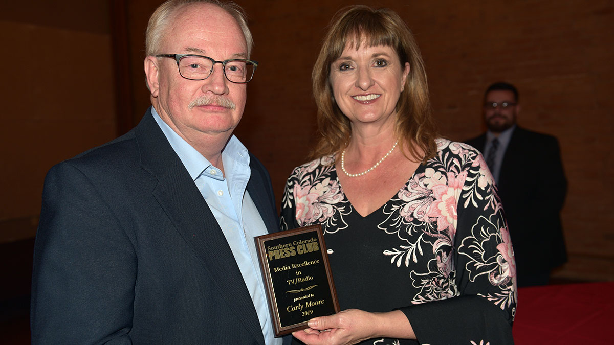 Dave Moore accepts the Media Excellence Award for TV/Radio for Carly Moore