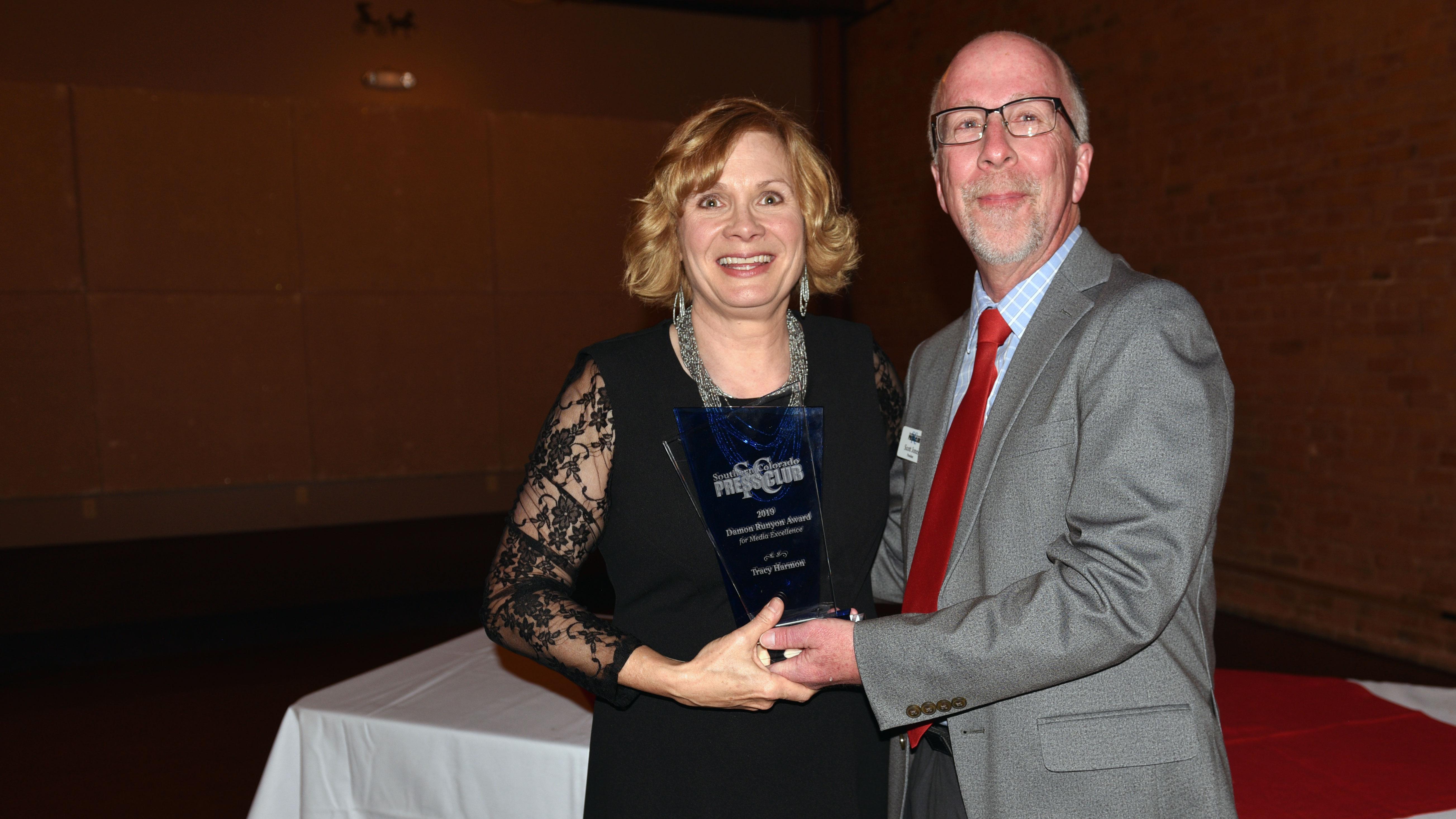 Damon Runyon Award winner Tracy Harmon with SCPC President Scott Jones