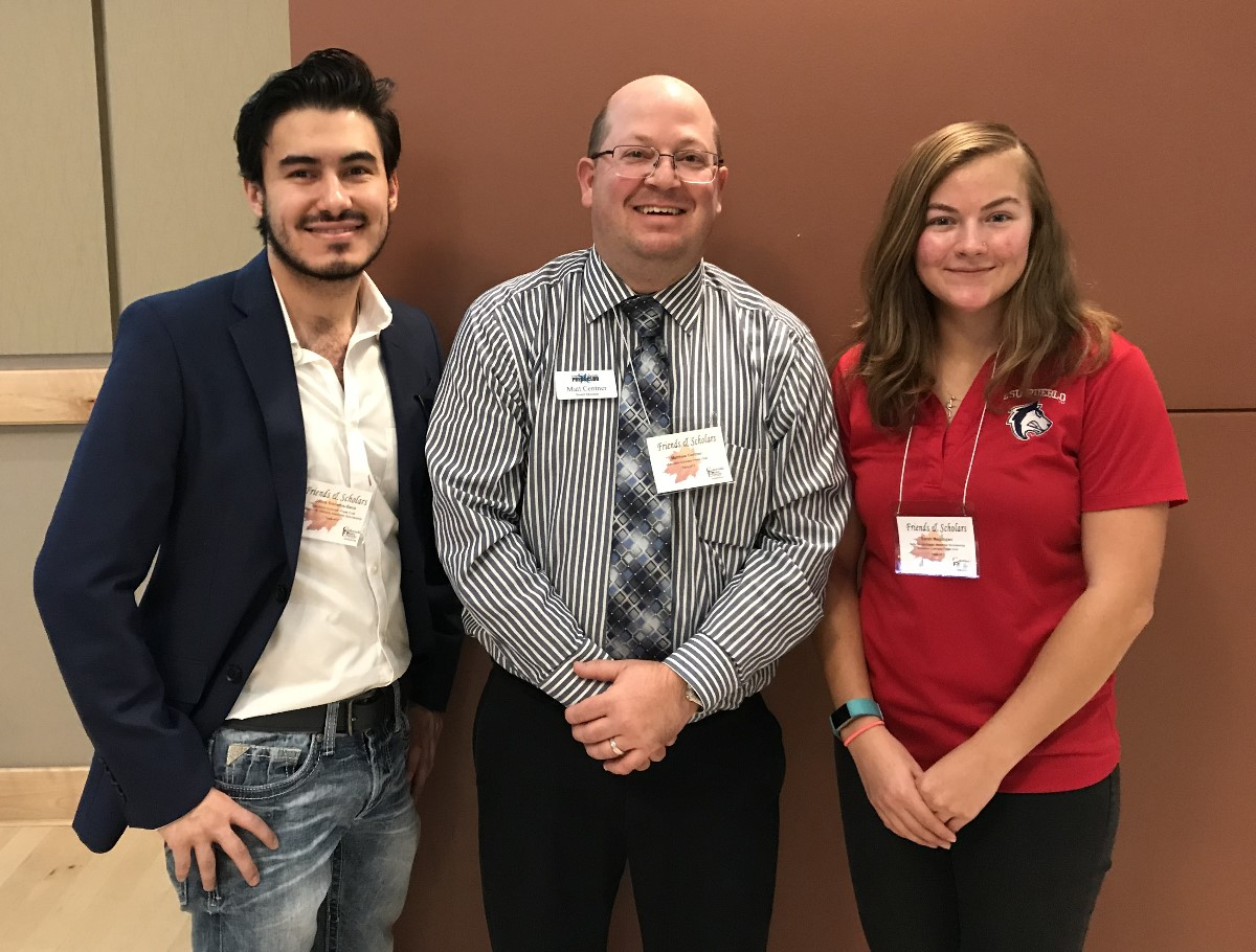 Jacob Sisneros-Baca, left, and Sarah Megilligan, right, join Southern Colorado Press Club President Matt Centner, center, at the 2019 Colorado State University-Pueblo Friends & Scholars Luncheon.